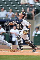 NW Arkansas Naturals catcher Micah Gibbs (27) tracks a pop up during a game against the Corpus Christi Hooks on May 26, 2014 at Arvest Ballpark in Springdale, Arkansas.  NW Arkansas defeated Corpus Christi 5-3.  (Mike Janes/Four Seam Images)