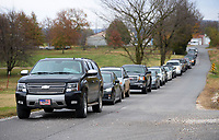 A long line of cars waits Saturday, Nov. 14, 2020, to take advantage of a drive-through vaccination clinic at Country Vet Service in Farmington. Hundreds of residents lined up to have their pets vaccinated. Visit nwaonline.com/201115Daily/ for today's photo gallery. <br /> (NWA Democrat-Gazette/Andy Shupe)