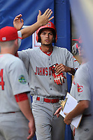 Center fielder Carlos Torres (21) of the Johnson City Cardinals is congratulated in the dugout after scoring in a game against the Danville Braves on Friday, July 1, 2016, at Legion Field at Dan Daniel Memorial Park in Danville, Virginia. Johnson City won, 1-0. (Tom Priddy/Four Seam Images)