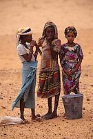 Near Niamey, Niger. Three Fulani Girls, with Water Bucket.