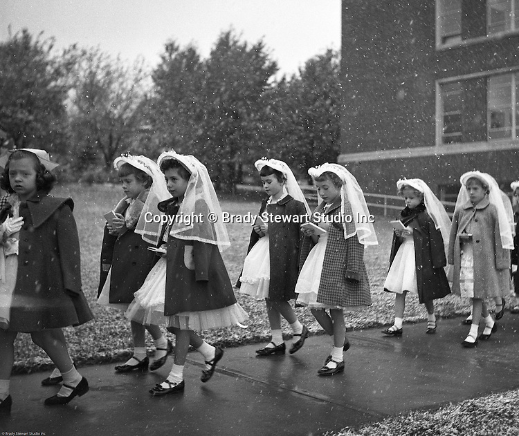 Bethel Park PA:  View of young catholic girls walking to church to receive their first holy communion at Saint Valentine's Church in Bethel Park PA.  Cathy Stewart was part of the class that received their first holy communion in 1954.  St Valentine's school opened in 1953 and is still in operation today.  Brady and Cathy Stewart attended the school from 1st thru 8th grades.  Michael Stewart attended from 1st thru 3rd grades.  He left and went to Hillcrest Elementary school after a disagreement with one of the nuns over a tuna fish sandwich!