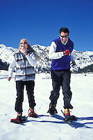 Couple running snowshoeing