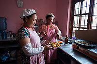 Nepal, Kathmandu. The Village Cafe in Patan serves traditional Nepalese food. Run by the non profit Sabah, employs women workers.