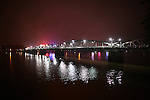 A bridge over the Perfume River is illuminated at night in Hue, Vietnam. Dec. 27, 2012.