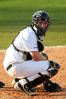 UCF Knights catcher / third baseman Chris Taladay #20 looks to the dugout during a game against the Siena Saints at the UCF Baseball Complex on March 3, 2012 in Orlando, Florida.  UCF defeated Siena 6-4.  (Mike Janes/Four Seam Images)