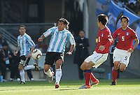 Forward Carlos Tevez wins a loose ball in the midfield. Argentina defeated South Korea, 4-1, in both teams' second match of play in Group B of the 2010 FIFA World Cup. The match was played at Soccer City in Johannesburg, South Africa June 17th.