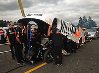 Aug. 5, 2011; Kent, WA, USA; Crew members for NHRA funny car driver Brian Thiel during qualifying for the Northwest Nationals at Pacific Raceways. Mandatory Credit: Mark J. Rebilas-