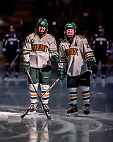 9 February 2018: University of Vermont Catamount Forwards Saana Valkama, a Junior from Pirkkala, Finland (left), and Alyssa Gorecki, a Junior from Monee, IL (right), are introduced in the spotlight prior to a game against the University of Connecticut Huskies at Gutterson Fieldhouse in Burlington, Vermont. The Lady Cats shut out the Huskies 1-0 in the first game of their weekend Hockey East series. Mandatory Credit: Ed Wolfstein Photo *** RAW (NEF) Image File Available ***