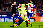 Lionel Messi of FC Barcelona (R) is challenged by Rodrigo Cascante of Atletico de Madrid (L) during the La Liga 2018-19 match between Atletico Madrid and FC Barcelona at Wanda Metropolitano on November 24 2018 in Madrid, Spain. Photo by Diego Souto / Power Sport Images