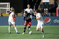 FOXBOROUGH, MA - MARCH 7: Gustavo Bou #7 of New England Revolution breaks away from tacklers during a game between Chicago Fire and New England Revolution at Gillette Stadium on March 7, 2020 in Foxborough, Massachusetts.