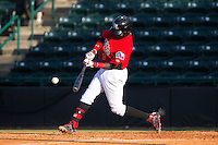 Michael De Leon (1) of the Hickory Crawdads makes contact with the baseball against the Savannah Sand Gnats at L.P. Frans Stadium on June 14, 2015 in Hickory, North Carolina.  The Crawdads defeated the Sand Gnats 8-1.  (Brian Westerholt/Four Seam Images)