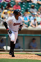 Birmingham Barons left fielder Eloy Jimenez (21) runs to first base during a game against the Pensacola Blue Wahoos on May 9, 2018 at Regions FIeld in Birmingham, Alabama.  Birmingham defeated Pensacola 16-3.  (Mike Janes/Four Seam Images)
