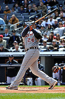 Apr 03, 2011; Bronx, NY, USA; Detroit Tigers outfielder Miguel Cabrera (24) hits his first of 2 home runs during game against the New York Yankees at Yankee Stadium. Tigers defeated the Yankees 10-7. Mandatory Credit: Tomasso De Rosa