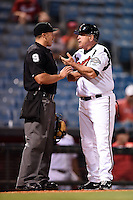 Nashville Sounds manager Rick Sweet (17) argues a call with home plate umpire Chris Gonzalez during a game against the Omaha Storm Chasers on May 19, 2014 at Herschel Greer Stadium in Nashville, Tennessee.  Nashville defeated Omaha 5-4.  (Mike Janes/Four Seam Images)
