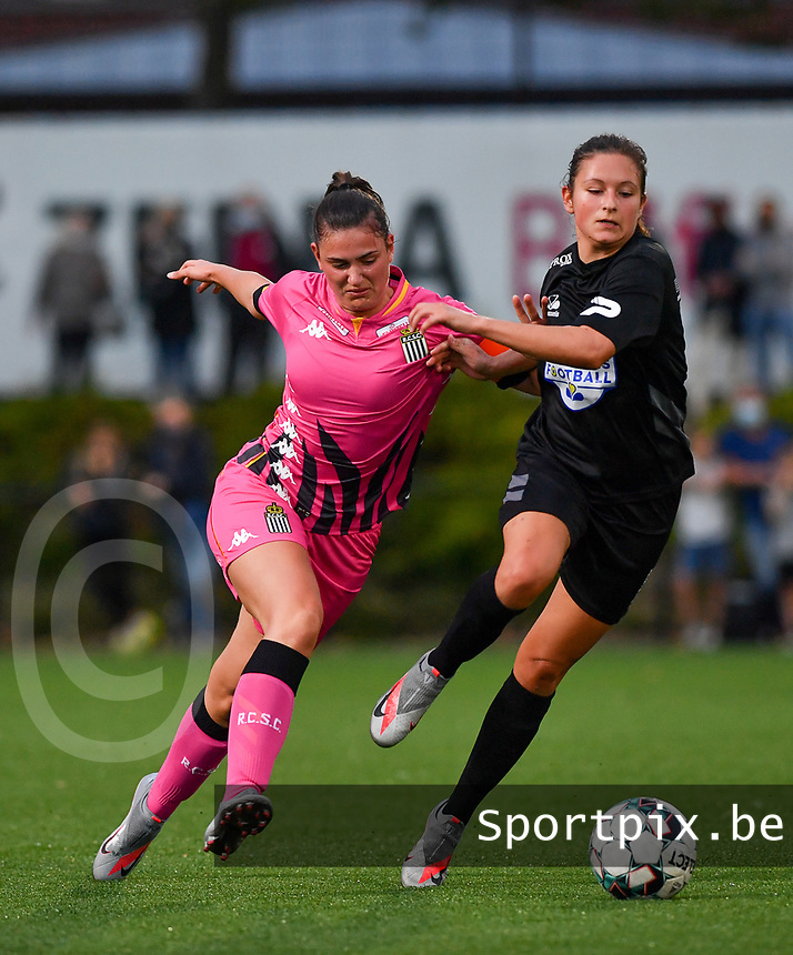 defender Noemie Fourdin of Sporting Charleroi pictured in a fight for the ball with Woluwe's Kenza Vrithof (9) during a female soccer game between Sporting Charleroi and FC Femina White Star Woluwe on the second matchday of the 2020 - 2021 season of Belgian Scooore Women s SuperLeague , friday 4 th of September 2020  in Marcinelle , Belgium . PHOTO SPORTPIX.BE | SPP | DAVID CATRY