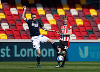 17th April 2021; Brentford Community Stadium, London, England; English Football League Championship Football, Brentford FC versus Millwall; Scott Malone of Millwall challenges Mads Roerslev of Brentford