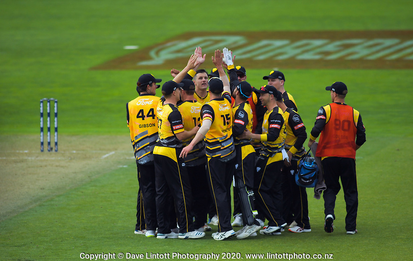 The Firebirds celebrate a wicket during the Dream11 Super Smash cricket final between the Wellington Firebirds and Auckland Aces at Basin Reserve in Wellington, New Zealand on Sunday, 19 January 2020. Photo: Dave Lintott / lintottphoto.co.nz