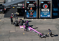 Nov 1, 2020; Las Vegas, Nevada, USA; Crew members push the dragster of NHRA top fuel driver Antron Brown into the pit area during the NHRA Finals at The Strip at Las Vegas Motor Speedway. Mandatory Credit: Mark J. Rebilas-USA TODAY Sports