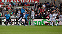 Pictured: Angel Rangel (centre) of Swansea City in action. Saturday 17 September 2011<br /> Re: Premiership football Swansea City FC v West Bromwich Albion at the Liberty Stadium, south Wales.