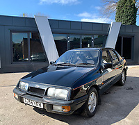 BNPS.co.uk (01202 558833)<br /> Pic: HampsonAuctions/BNPS<br /> <br /> Pictured: 1986 Ford Sierra XR4X4.<br /> <br /> Since the 1990s, Geoff Barlow, 46, has collected dozens of classic cars from an Escort Mexico replica to several types of Transit, Cortina, and Sierra.<br /> <br /> However, he still regrets selling the first car which inspired his passion, a 1980 Escort Mark 2 he bought from his sister in 1992.  <br /> <br /> Geoff's fascination with Fords gathered pace in the last decade and he 'lost control,' buying as many Fords as he came across and saving them from disrepair.