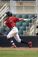 Luis Curbelo (16) of the Kannapolis Intimidators follows through on his swing against the Greensboro Grasshoppers at Kannapolis Intimidators Stadium on August 5, 2018 in Kannapolis, North Carolina. The Grasshoppers defeated the Intimidators 2-1 in game one of a double-header.  (Brian Westerholt/Four Seam Images)