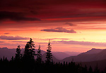 Sunrise turns the North Cascades' sky into a variety of colors, Washington