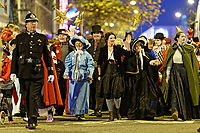 """Pictured: Actress Michelle McTernan (C) with locals dressed as festive characters lead the Christmas parade in Swansea, Wales, UK. Sunday 19 November 2018<br /> Re: Swansea Christmas parade attended by thousands has been branded a """"shambles"""" for having just three floats.<br /> The annual festive event in south Wales, which took place on Sunday, promised """"dynamic dance-troupes"""" as well as """"spectacular shows and stages"""".<br /> But the parade was scaled down, leading to a barrage of criticism on social media because of roadworks in the city centre. <br /> The leader of Swansea Council, Rob Stewart apologised on Facebook and said the parade was not """"good enough"""".<br /> Parents took on social media to voice their anger, calling the event """"a load of rubbish"""" and claiming there was nothing for young children apart from """"a loud music float with Santa on""""."""