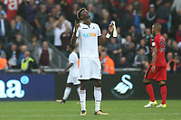 Tammy Abraham of Swansea City points the sky as he celebrates Swanseas win after the final whistle of the Premier League match between Swansea City and Huddersfield Town at The Liberty Stadium, Swansea, Wales, UK. Saturday 14 October 2017