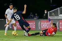 FORT LAUDERDALE, FL - DECEMBER 09: Sebastian Soto #19 of the United States and Henry Hernandez #1 of El Salvador collide in the goal mouth during a game between El Salvador and USMNT at Inter Miami CF Stadium on December 09, 2020 in Fort Lauderdale, Florida.