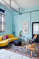 A converted shoe factory blends old world flavour with warehouse edge. In a sitting corner etchings by Hatem Imam hang on the wall above an 18th century Ottoman table. An Eames chair, a vintage kidney sofa and Damascus inlaid side tables complete the room