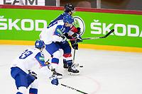 23rd May 2021, Riga Olympic Sports Centre Latvia; 2021 IIHF Ice hockey, Eishockey World Championship, Great Britain versus Slovakia;  19 Matus Sukel Slovakia try to stop 7 Robert Lachowicz Great Britain