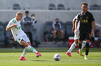 LOS ANGELES, CA - APRIL 17: Alex Ring #8 of Austin FC passes off a ball during a game between Austin FC and Los Angeles FC at Banc of California Stadium on April 17, 2021 in Los Angeles, California.