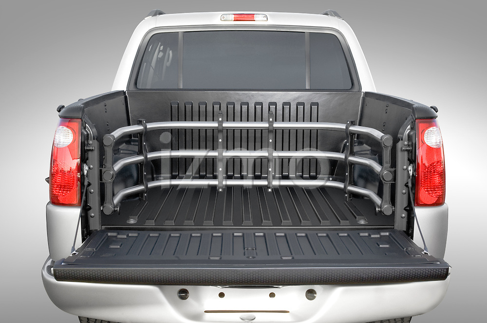 Straight rear view of a 2005 Ford Explorer Sport Trac pick up bead with tailgate open
