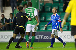 Hibs v St Johnstone...28.09.11   SPL Week.Ref Steve Conroy pulls Akpo Sodje away from Jody Morris.Picture by Graeme Hart..Copyright Perthshire Picture Agency.Tel: 01738 623350  Mobile: 07990 594431