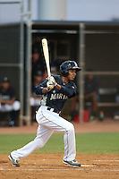 Erick Mejia of the AZL Mariners bats against the AZL Giants at the Peoria Sports Complex on July 10, 2014 in Peoria, Arizona. AZL Giants defeated the AZL Mariners, 8-4. (Larry Goren/Four Seam Images)