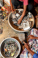People sift through used electronics in a village near Kolkata which recycle e-waste.<br /> <br /> To license this image, please contact the National Geographic Creative Collection:<br /> <br /> Image ID: 1925793 <br />  <br /> Email: natgeocreative@ngs.org<br /> <br /> Telephone: 202 857 7537 / Toll Free 800 434 2244<br /> <br /> National Geographic Creative<br /> 1145 17th St NW, Washington DC 20036