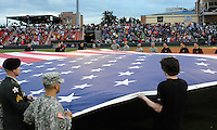 Members of the US Army's recruiting command for the Upstate unfurl a huge American flag before the Greenville Drive's Opening Day game on April 5, 2012, at Fluor Field at the West End in Greenville, South Carolina. (Tom Priddy/Four Seam Images)