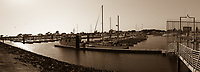 Changes at the San Leandro Marina are captured in a sepia toned, multiple image, panoramic.