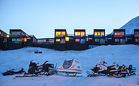 Snowmobiles parked outside homes in the town of Longyear. Svalbard (formerly known by its Dutch name Spitsbergen) is a Norwegian archipelago in the Arctic Ocean. Situated north of mainland Europe, it is about midway between continental Norway and the North Pole. <br /> <br /> <br /> (photo: Fredrik Naumann/Felix Features)
