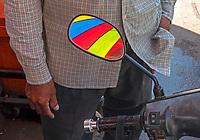 Umbrella reflecting in a motor bike mirror Battambang, Cambodia