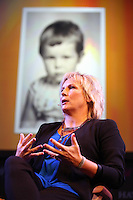 Saturday 24 May 2014, Hay on Wye UK<br /> Pictured: Jennifer Saunders with a picture of her when she was a little girl in the background screen.<br /> Re: The Telegraph Hay Festival, Hay on Wye, Powys, Wales UK.