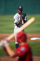 Mahoning Valley Scrappers starting pitcher Juan Hillman (25) gets ready to deliver a pitch to batter Ryan Ripken during a game against the Auburn Doubledays on June 19, 2016 at Falcon Park in Auburn, New York.  Mahoning Valley defeated Auburn .  (Mike Janes/Four Seam Images)