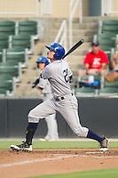 David Dahl (21) of the Asheville Tourists follows through on his swing against the Kannapolis Intimidators at CMC-NorthEast Stadium on July 13, 2014 in Kannapolis, North Carolina.  The Tourists defeated the Intimidators 8-2.  (Brian Westerholt/Four Seam Images)