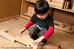 Education preschool 3-4 year olds block area boy at work horizontal