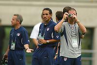 USA's Jeff Agoos, with Pablo Mastroeni to his left, takes photos of the stadium. The USA tied South Korea, 1-1, during the FIFA World Cup 2002 in Daegu, Korea.