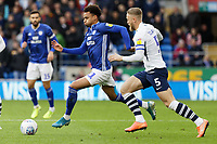(L-R) Josh Murphy of Cardiff City moves th ball forward while closely marked by Tom Clarke of Preston North End during the Sky Bet Championship match between Cardiff City and Preston North End at the Cardiff City Stadium, Wales, UK. Saturday 21 December 2019