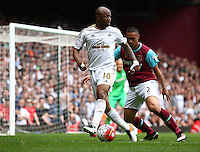 Andre Ayew of Swansea and Winston Reid of West Ham United   during the Barclays Premier League match between West Ham United and Swansea City  played at Boleyn Ground , London on 7th May 2016
