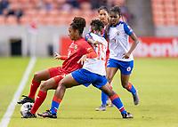 HOUSTON, TX - FEBRUARY 3: Katherine Castillo #8 of Panama controls the ball as Johane Laforte #15 of Haiti defends during a game between Panama and Haiti at BBVA Stadium on February 3, 2020 in Houston, Texas.