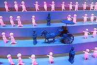 China. Shanghai. World Expo. Expo 2010 Shanghai China.  China Pavilion. Pink illuminated plastic dancing figures. Old statues and horse carriage in the Henan pavilion. Traditional art. 25.06.10 © 2010 Didier Ruef
