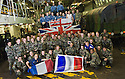 MEMBERS OF THE FRENCH MARINES AND THE ROYAL NAVY ON THE VEHICLE DECK OF HMS BULWARK AHEAD OF WATCHING THE RUGBY WORLD CUP QUARTER FINAL BETWEEN THEIR TWO COUNTRIES WHILST ON A BREAK FROM A JOINT EXERCISE IN LOCH EWE AND OFF THE SCOTTISH ATLANTIC COAST